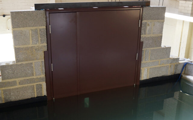 Steel flood doors